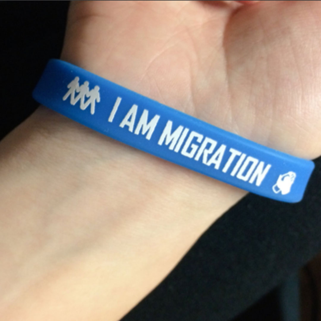 Lewis University Student Ambassador with an I am Migration wrist band