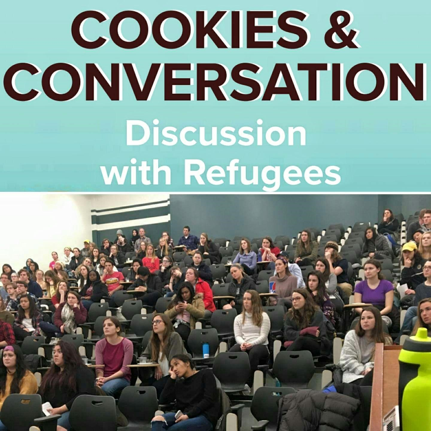 """Cookies and Conversation discussion with refugees"" poster with students in an auditorium"